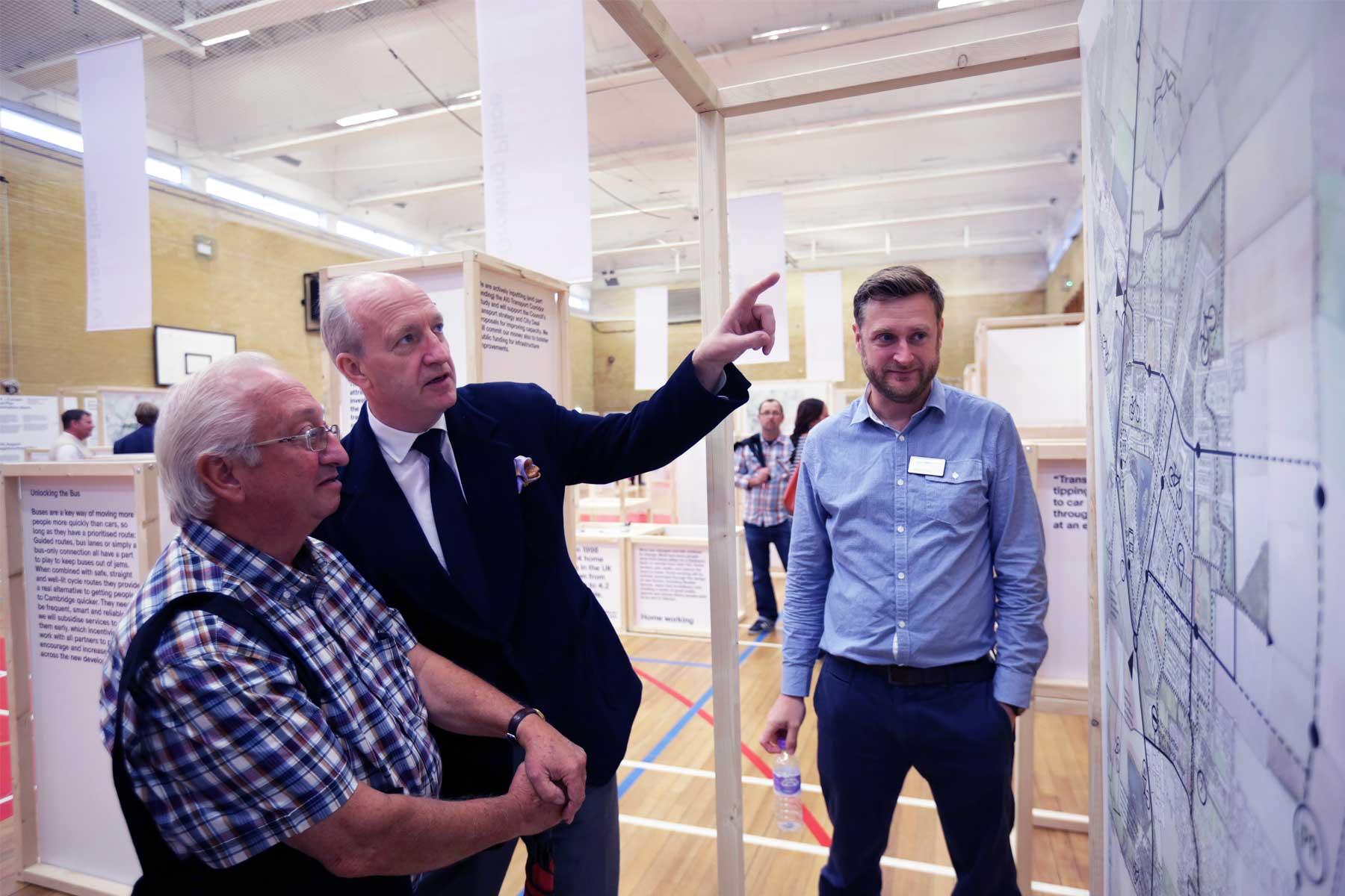 3 men looking at Waterbeach plans
